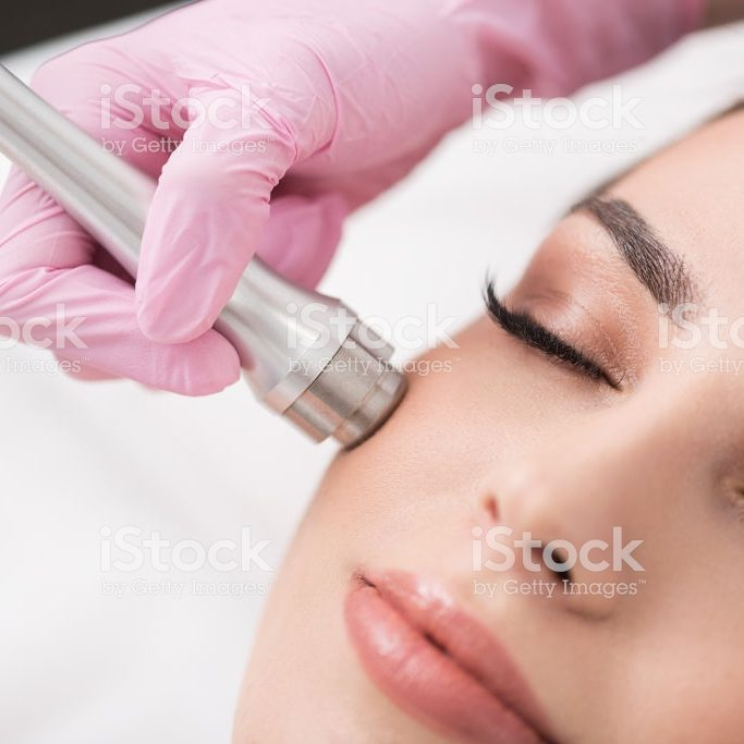 Charming lady is getting cosmetic treatment in spa